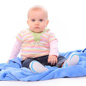 Cute baby sitting on blue towel. — Stock Photo