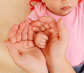 Little baby fingers in mother's hands. — Stock Photo