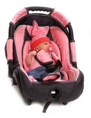 Baby in safety seat. Safety and insurance concept — Stok fotoğraf