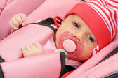 Baby in safety seat. Safety and insurance concept — Stock Photo