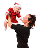 Happy young mother with cute baby dressed as Santa — Stock Photo