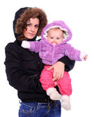 Young highlander with her baby dressed in a fur — Stock Photo