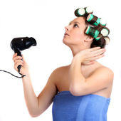 Nice girl with colorful hair-curlers — Stock Photo