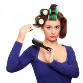 Nice girl with colorful hair-curlers — 图库照片