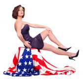 Pin up girl sitting on a american flag. — Stock Photo