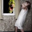 Stock Photo: Screaming green zombie and fright little girl