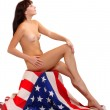 Low key studio shot. Young attractive girl dressed in american flag. — Stock Photo #33183637