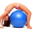 Sporty young woman with blue ball. — Stock Photo #33183933
