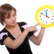 Beautiful blonde holding funny clock. Conceptual image. — Stock Photo #33187549