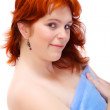 Attractive young redhaired woman dressed in blue towel — Stock Photo