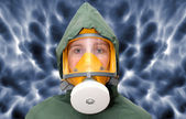 Woman wearing gas mask and protective suit. — Stock Photo