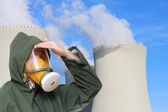 Woman wearing gas mask and protective suit. — Foto Stock