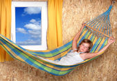 Resting young girl on a hammock in living room — Stock Photo