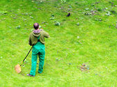 Gardener cleaning on golf course. — Stock Photo