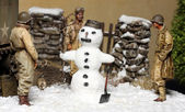 Army soldiers and Snowman — Stock Photo