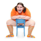 Crazy teenager on a blue chair. Behavioral disturbance in the pubescence. — Stock Photo