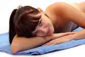 Picture of attractive suntanned girl dressed in blue towel — Stock Photo