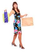 Shopping pretty woman - studio shot on white background — Stock fotografie