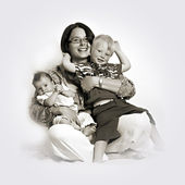 Loving mother holding babies — Stock Photo