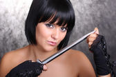Girl with a dagger — Stock Photo