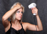 Nice girl with hair-drier. — Stock Photo