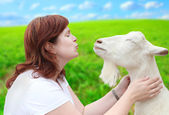 Woman with goat. — Stock Photo