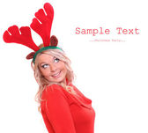 Happy young woman with reindeer attire on a christmas party. — Stock Photo