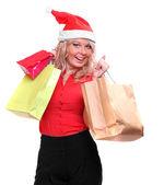 Shopping pretty woman in Santa Claus costume — Zdjęcie stockowe