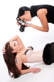 Professional photographer and a model working in a studio. — Stock Photo