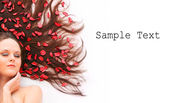 Beautiful young woman with flowers on her long hair and easy removable text. — Stock Photo