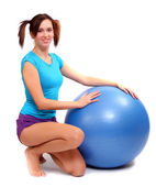 Porty young woman with pilates ball — Stock Photo