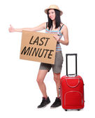 Happy asian woman going on vacation with schedule and her suitcase. — Stock Photo