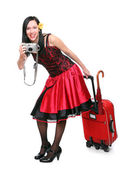 Young woman going on vacation with her suitcase. — Stock Photo