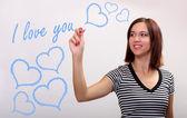 Young beautiful girl writing valentine greeting. — Stock Photo