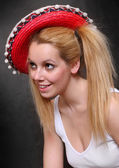 Picture of a happy teenage girl wearing a sombrero. — Stock Photo