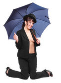 Crazy businesswoman in bowler hat with umbrella. — Foto Stock