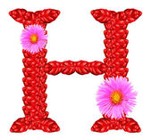 Letter H from red leaves and aster flowers — Stock Photo