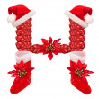Christmas letter H  with Santa Claus cap and stocking.  — Stock Photo