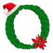 Christmas letter O with Santa Claus cap and stocking. — Stock Photo