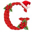 Christmas letter G with Santa Claus cap. — Stock Photo
