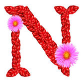 Letter N from red leaves and aster flowers — Stock Photo