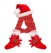 Christmas letter A with Santa Claus cap and stocking. — Stock Photo
