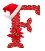Christmas letter F with Santa Claus cap and stocking. — Stock Photo