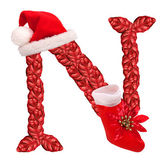 Christmas letter N with Santa Claus cap and stocking. — Stock Photo