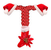 Christmas letter T with Santa Claus cap and stocking. — Stock Photo