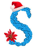 Christmas letter S with Santa Claus cap — Stock Photo