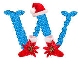 Christmas letter W with Santa Claus cap and stocking. — Stock Photo
