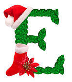 Christmas letter E with Santa Claus cap and stocking. — Stock Photo