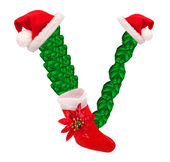 Christmas letter V with Santa Claus cap and stocking. — Stock Photo