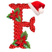 Christmas letter F with Santa Claus cap. — Stock Photo